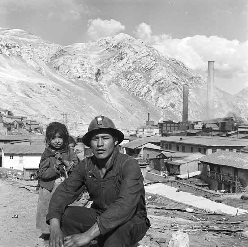 Worker with child at Silver mine Bolivia 1952