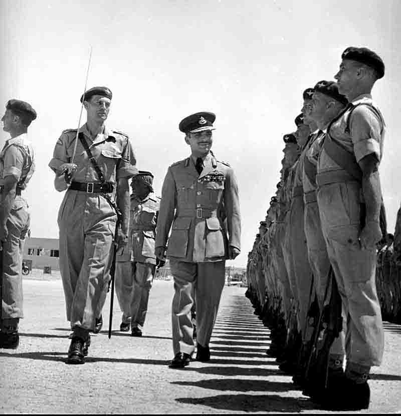 King Hussein of Jordan inspecting Military personal