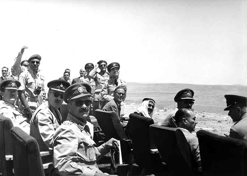King Hussein of Jordan with Military personal