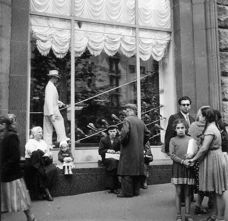 People in front of a shop window