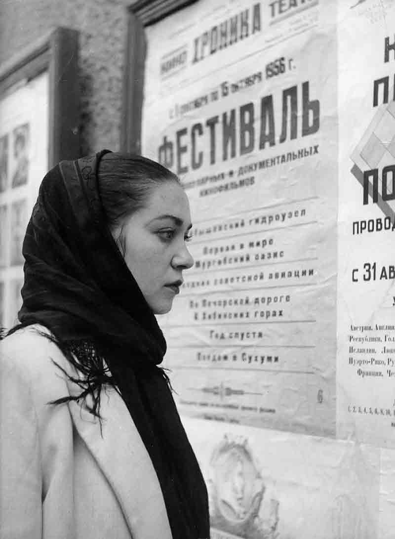 Young woman in Moscow reading announcement